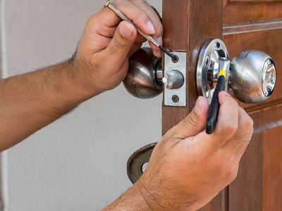 residential locksmith repairing a door lock